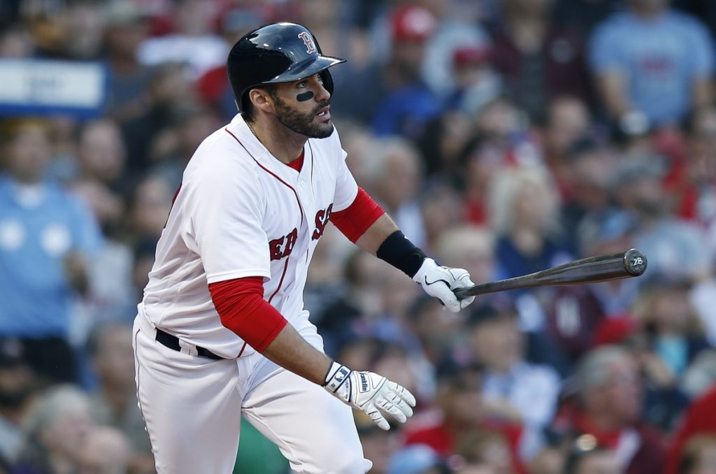 Boston's J.D. Martinez watches his three-run home run during the fourth inning of the Red Sox' 10-2 win over the Yankees on Sunday at Fenway Park in Boston.