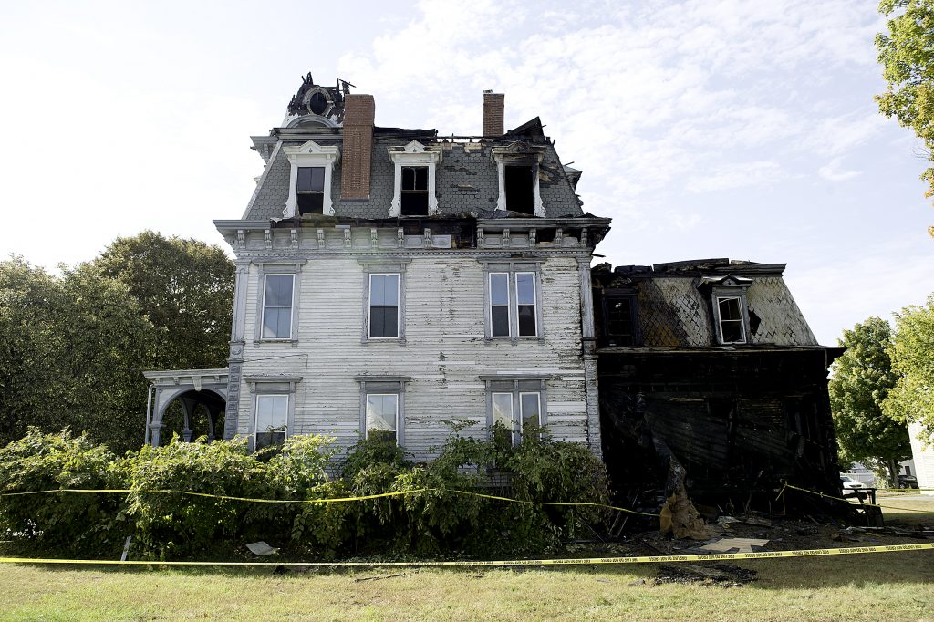 Fire destroyed the historic Charles A. Jordan House at 63 Academy St. early Sunday morning.