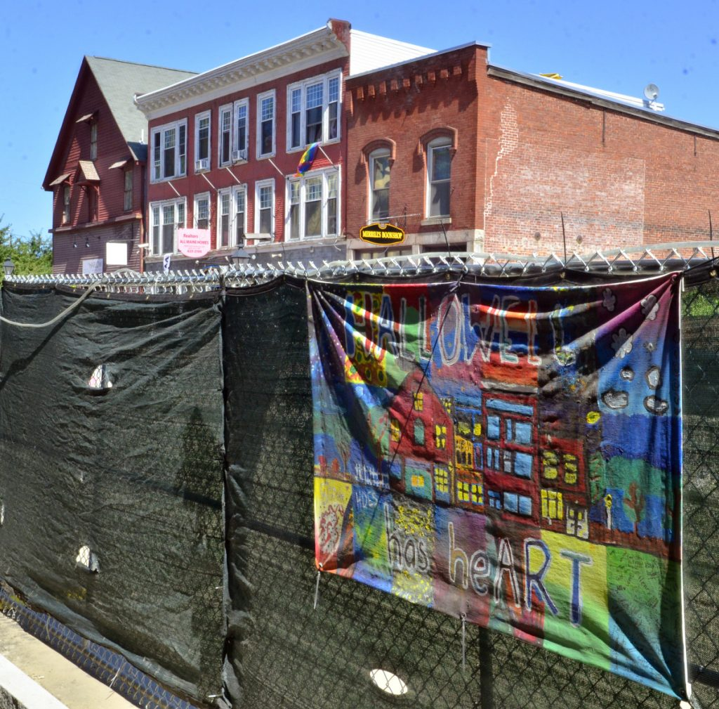 A murals hanging on the fence Friday along Water Street in Hallowell.