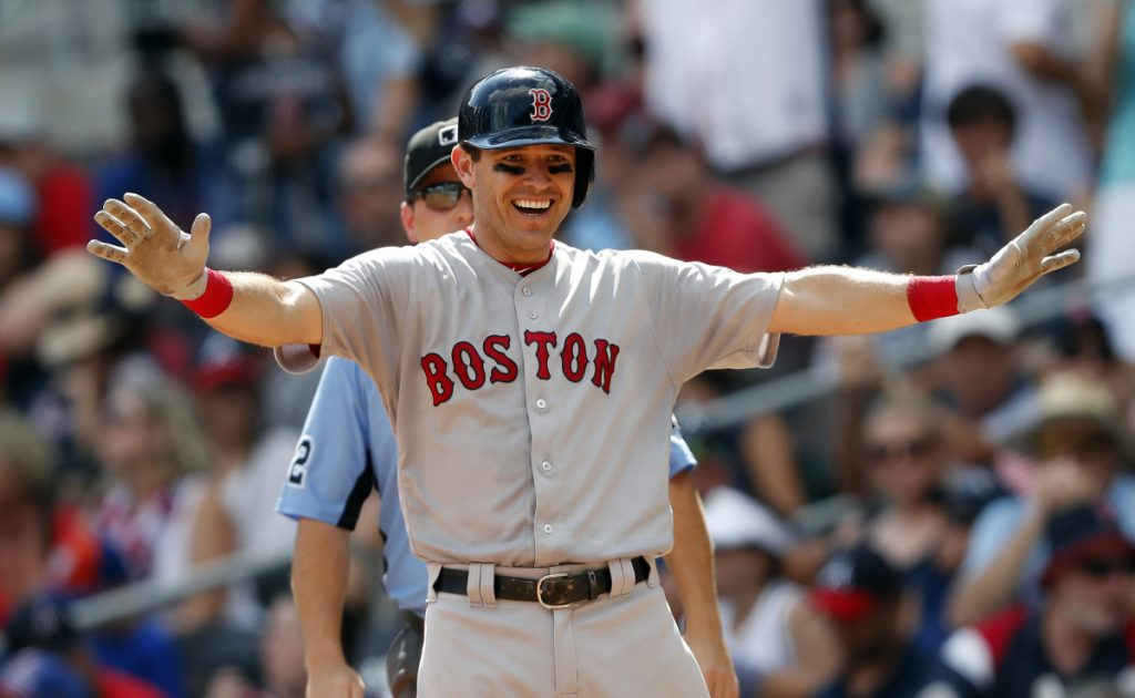 Boston Red Sox second baseman Ian Kinsler reacts after driving in two runs with a base hit in the eighth inning Monday against the Atlanta Braves in Atlanta. Boston won 8-2.