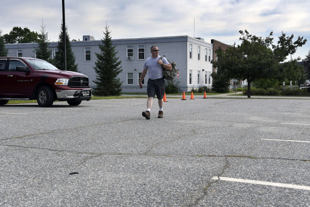 Augusta Police Officer Scott Taylor walks Tuesday to his car in the satellite parking lot of the agency's station after completing a shift. The city of Augusta is considering the lot as the site for a new headquarters for the department, along with several other locations, including downtown.