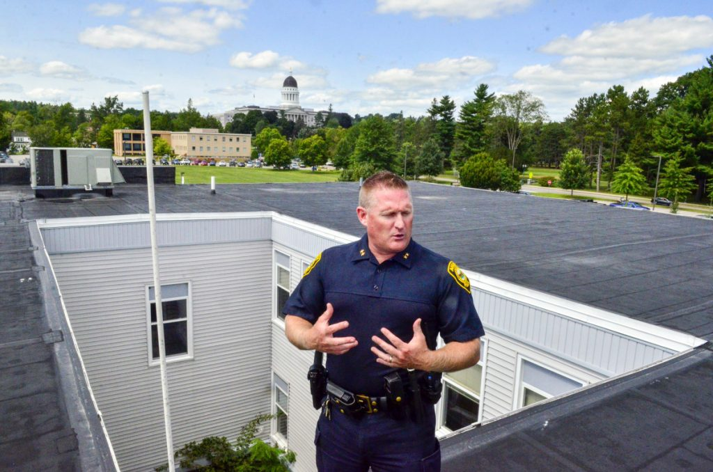 Augusta Police Chief Jared Mills is seen atop the Augusta Police Station on Aug. 21.