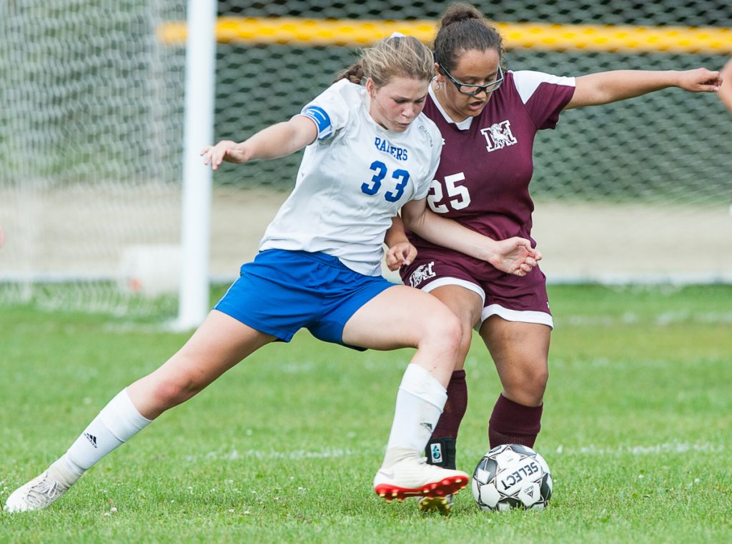 Oak Hill's Julia Noel, left, muscles in on Monmouth's Alexis Trott during Tuesday afternoon's girls soccer game in Monmouth.