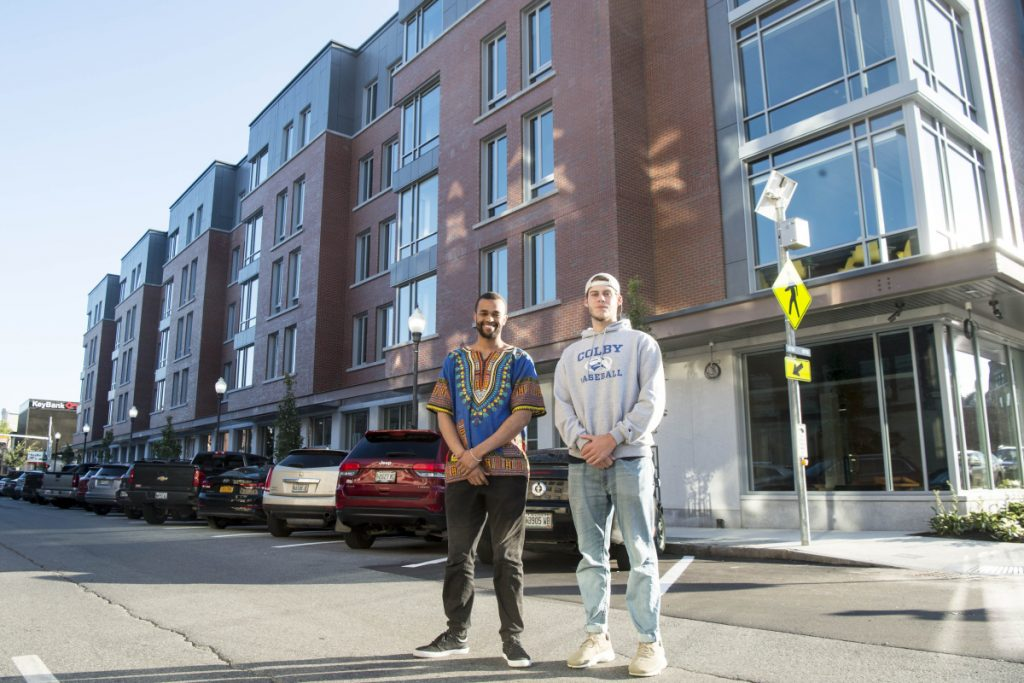 Colby College's new residential complex downtown will be open to the public for guided tours after its official opening at 10 a.m. Thursday. Colby students Moeketsi Justice Mokobocho, left, and Matt Reasor have been in residence at the Waterville downtown dormitory for a couple of weeks and were joined by other residents on Monday.