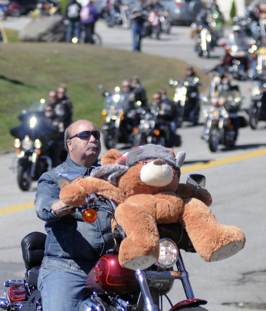 Bikers pour out of the Augusta Civic Center on Sept. 14, 2014, during the 33rd annual United Bikers of Maine Toy Run. Several hundred bikers from across Maine rode to the Windsor Fairgrounds carrying toys to donate to children.