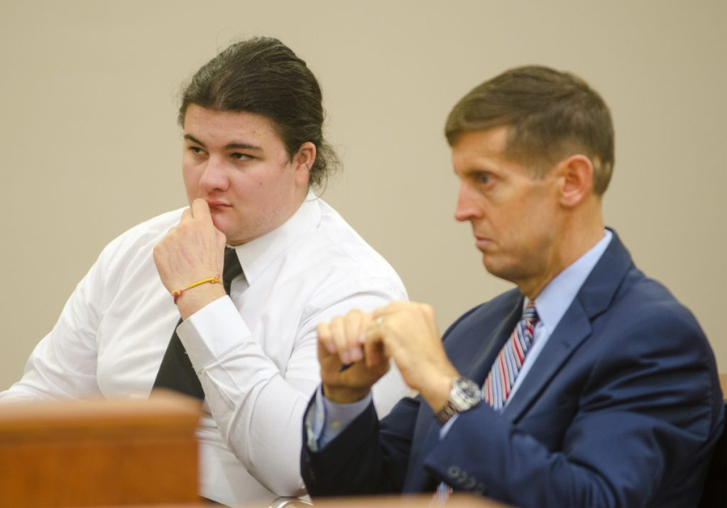Andrew Balcer, left, sits with his attorney Walter McKee during his bindover hearing on Oct. 26, 2017 at Capital Judicial Center in Augusta.