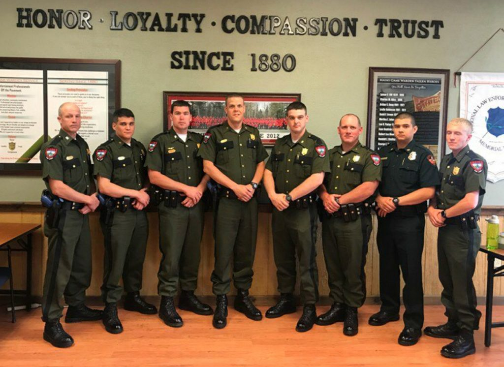 Graduates from left are Warden Jake Voter, from Cornville, who is assigned to The Forks; Warden Michael Latti, from Brunswick, assigned to the Gorham District; Warden Pilot Chris Hilton, from Greenville, assigned to Greenville; Warden Tyler Leach, from Mechanic Falls, assigned to Danforth; Warden James Gushee, from Fort Kent, assigned to Houlton; Warden Tennie Coleman, from Dennistown, assigned to Jackman; Warden Logan Pardilla assigned to the Penobscot Tribal Land; and Warden Brandon Sperrey, from Winterport, assigned to Saco.