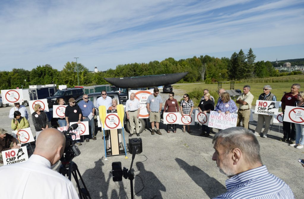 A crowd participates in the Say NO to NECEC Rally on Friday in Augusta. The protest against a proposed 145-mile transmission line through Maine to bring electricity to Massachusetts residents took place outside the Department of Environmental Protection response building in Augusta.