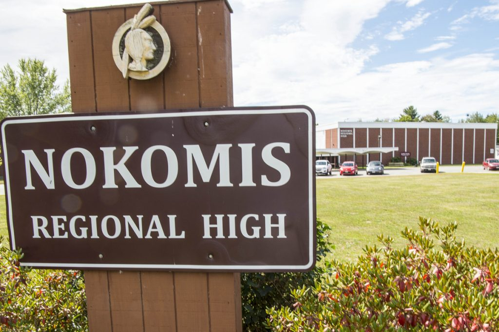 The image of an Indian appears above the Nokomis High School sign Thursday in front of the school in Newport.