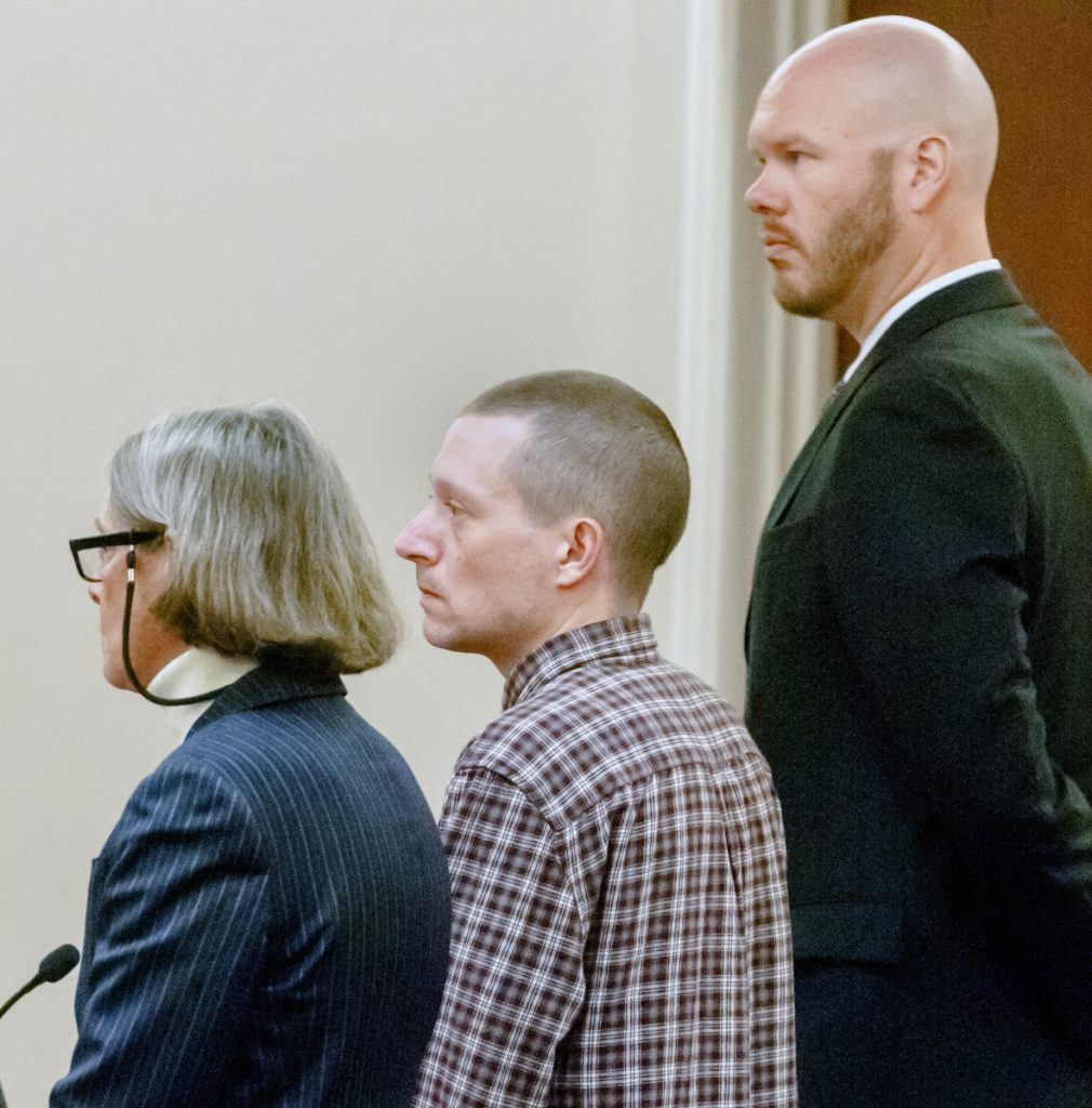 Scott A. Bubar, center, is flanked by his attorneys, Lisa Whittier, left, and Scott Hess, during bail hearing on Wednesday at the Capital Judicial Center in Augusta.