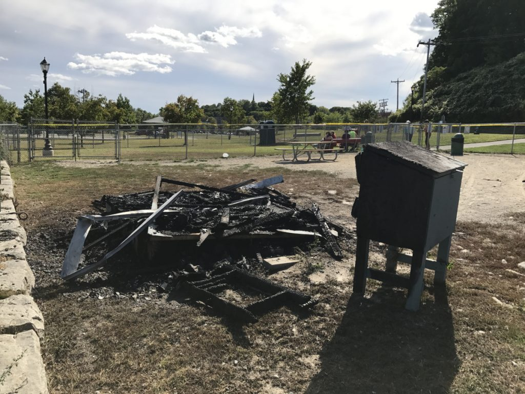 Charred rubble is all that remains Saturday of a shelter that once enabled dog owners to see protection in bad weather while their dogs ran around in a fenced enclosure at Mill Park in Augusta. The shelter burned Friday night, and police are investigating it as a likely case of arson.
