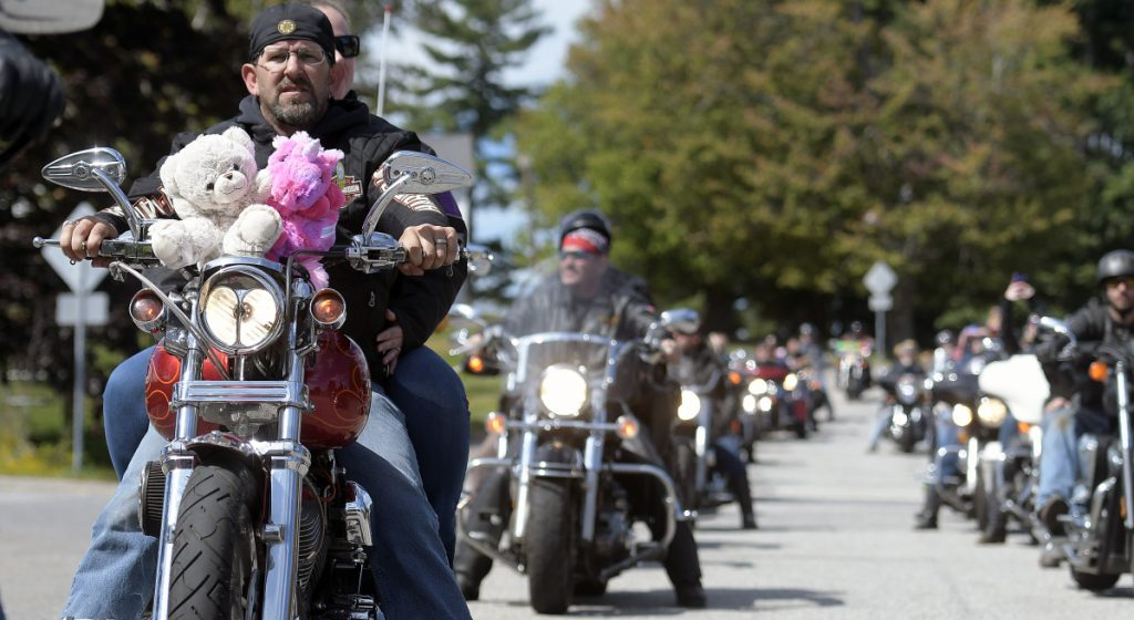 Motorcyclists ride through Augusta on Sunday at the annual United Bikers of Maine Toy Run.