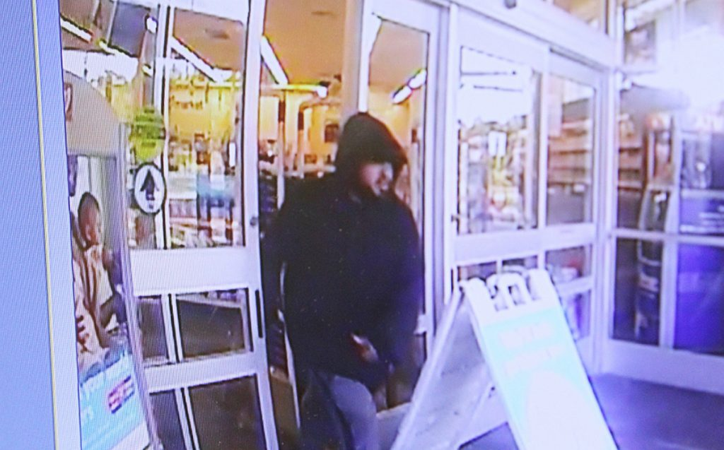 A surveillance camera image of the man suspected of robbing the Walgreens Pharmacy on Memorial Circle Sunday morning.