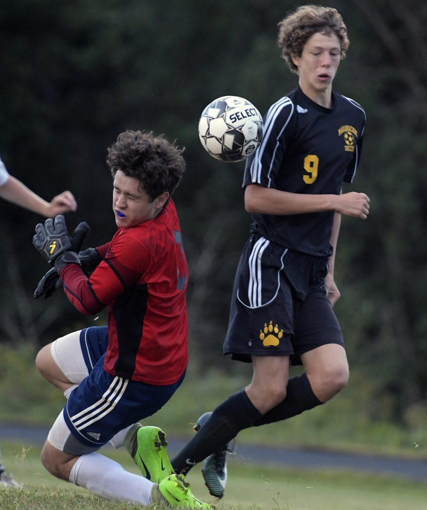 Maranacook's Richard Down can't get a shot by Medomak Valley's Aiden Starr during a soccer game Tuesday in Readfield.