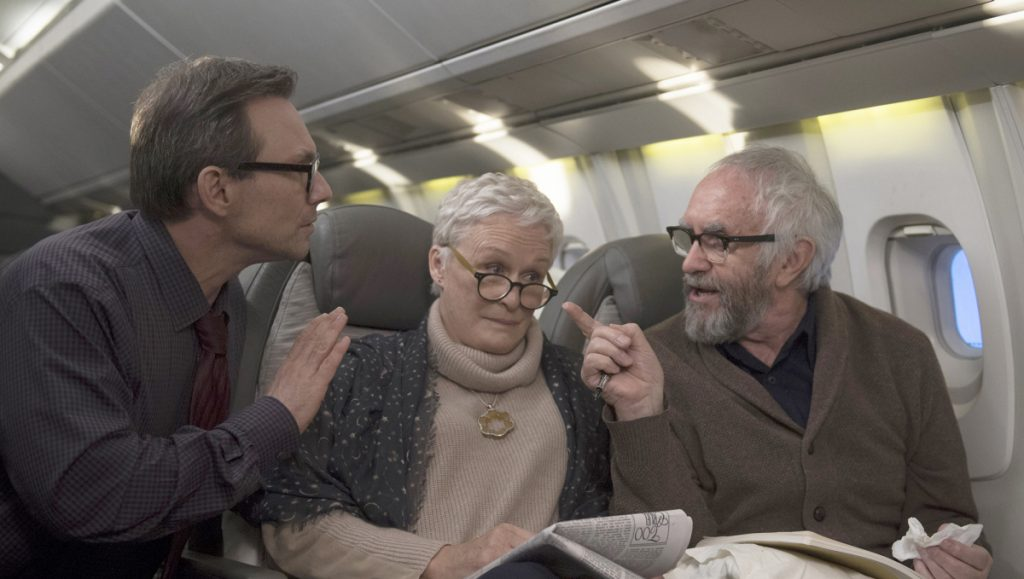 "Christian Slater, left, Glenn Close and Jonathan Pryce in ""The Wife."""