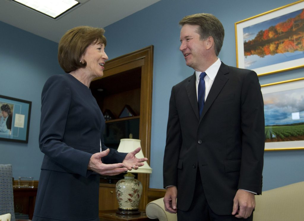 Sen. Susan Collins speaks with Supreme Court nominee Judge Brett Kavanaugh at her office, before a private meeting. As a rare potential swing vote in the Senate, she is the focus of an intense lobbying effort.