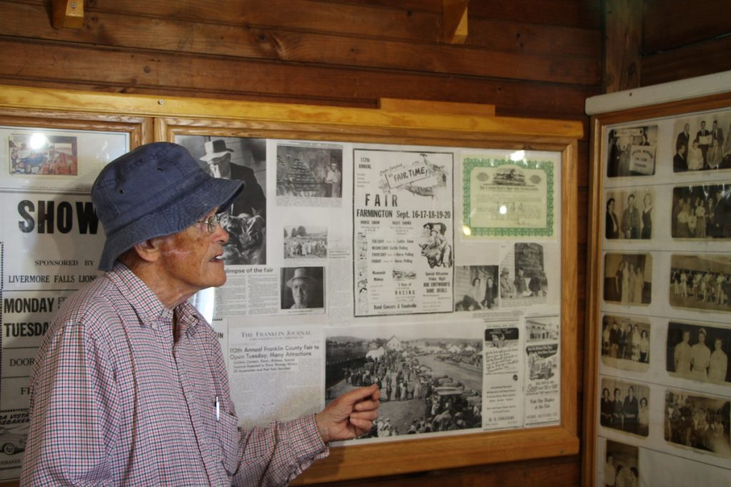 Local historian and fair volunteer Don DeRoche discusses a historical display that will be open for viewing during the 178th annual Farmington Fair.
