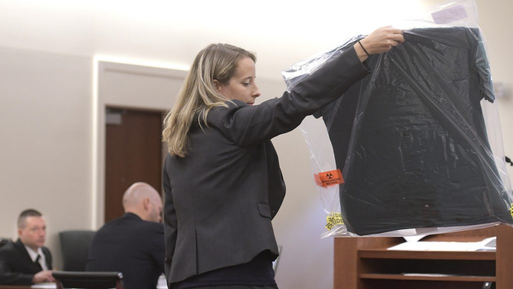 Scott Bubar, left, watches Assistant District Attorney Alisa Ross display a shirt Monday that she claims Bubar was wearing during a shootout with police on May 19, 2017, in Belgrade. Bubar is standing trial for his alleged attempted murder of a sheriff's deputy during the shootout, which killed his father.