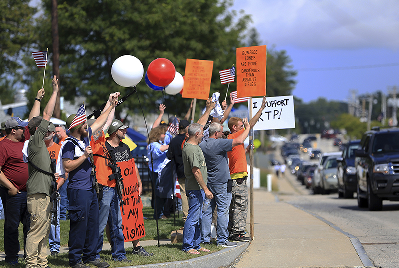 A large group of gun rights advocates gathered  Saturday show support for the Kittery Trading Post  as the Resistance Seacoast group held a protest in front of the sporting goods store.