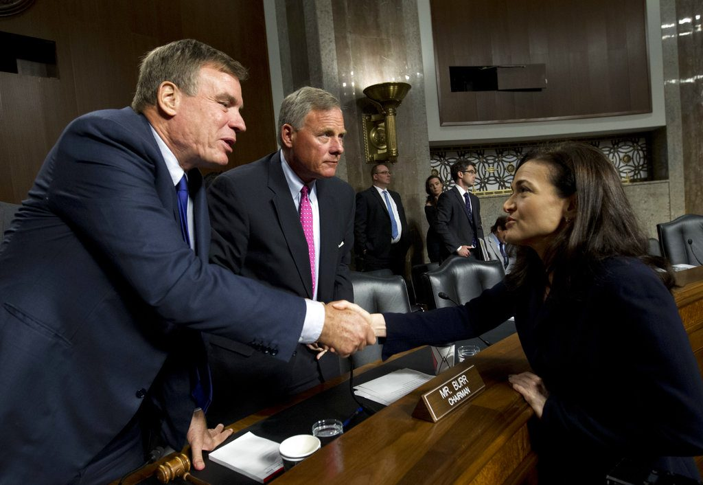 Senate Intelligence Committee Vice Chairman Mark Warner, D-Va., left, and Chairman Sen. Richard Burr, R-N.C., center, shake hands with Facebook COO Sheryl Sandberg after Senate Intelligence Committee hearing on 'Foreign Influence Operations and Their Use of Social Media Platforms' on Capitol Hill, Wednesday in Washington.