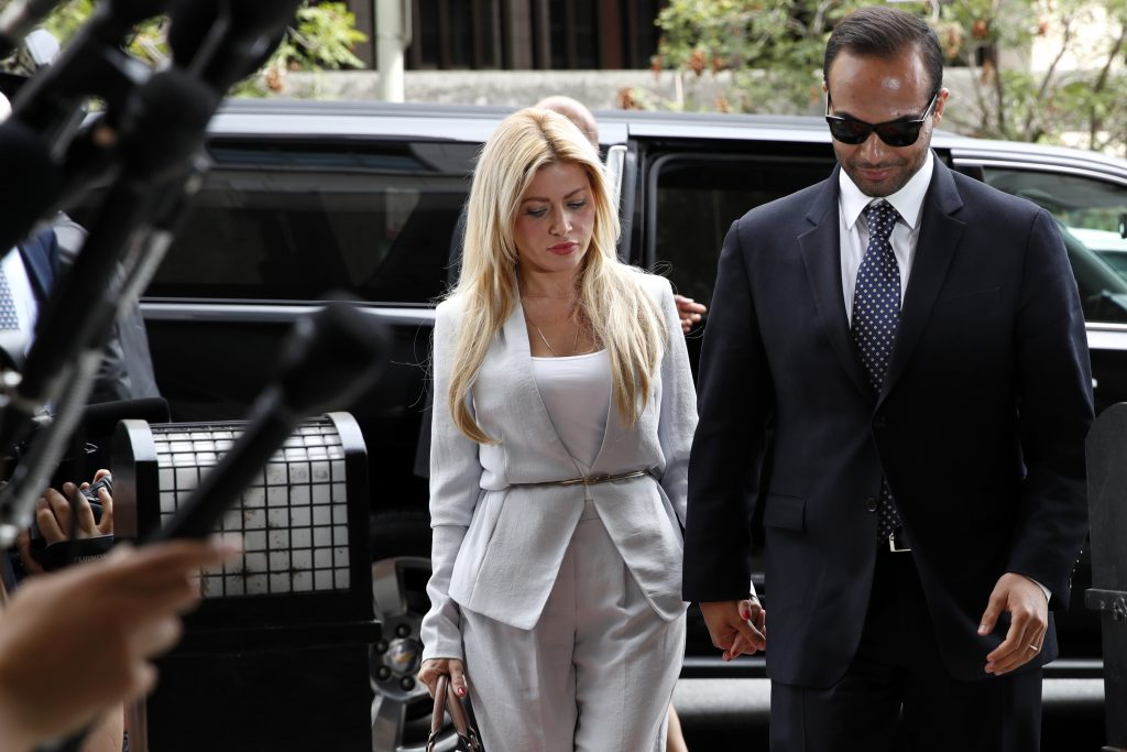 Former Donald Trump presidential campaign foreign policy adviser George Papadopoulos, right, who pleaded guilty to one count of making false statements to the FBI during the agency's Russia probe, holds hands with his wife Simona Mangiante, as they arrive at federal court for sentencing, Friday in Washington.