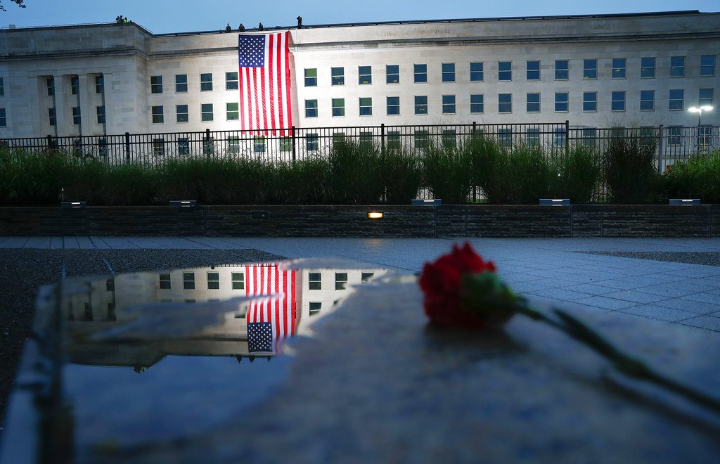 A U.S. flag is unfurled at sunrise on Tuesday, Sept. 11, at the Pentagon on the 17th anniversary of the Sept. 11, 2001, terrorist attacks.