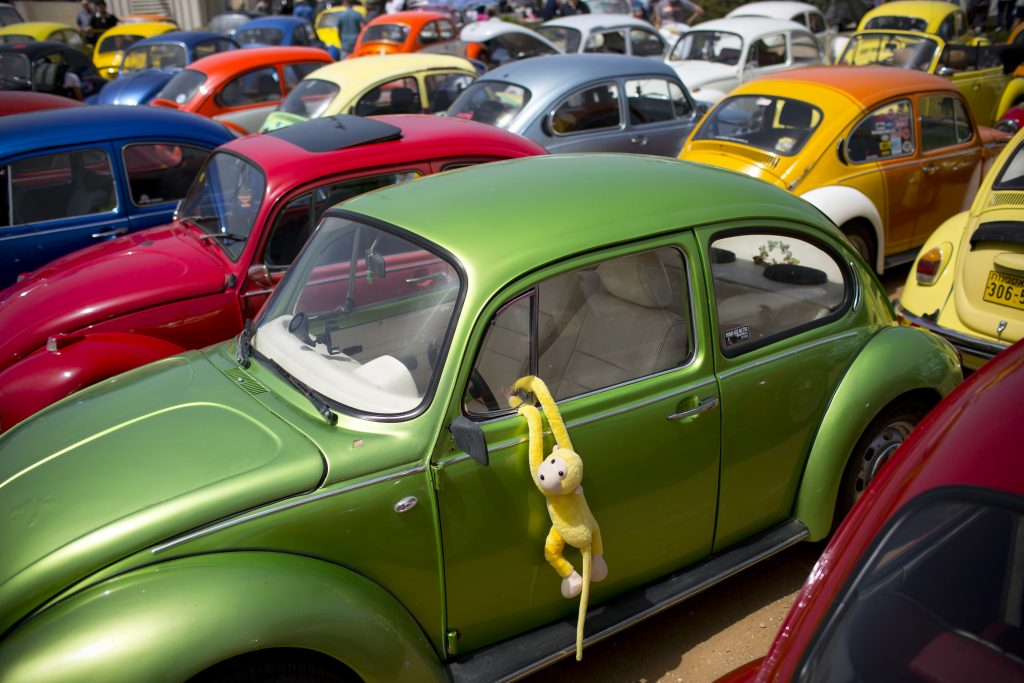 "In this April 21, 2017, file photo Volkswagen Beetles displayed during the annual gathering of the ""Beetle club"" in Yakum, central Israel. Volkswagen says it will stop making its iconic Beetle in July of next year. Volkswagen of America on Thursday, Sept. 13, 2018, announced the end of production of the third-generation Beetle by introducing two final special editions."