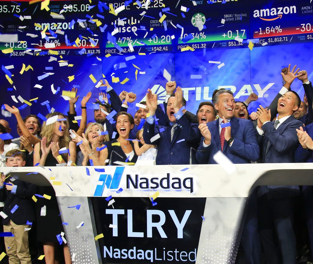 Brendan Kennedy, third from right in front, CEO and founder of British Columbia-based Tilray Inc., a major Canadian marijuana grower, leads cheers as confetti falls to celebrate his company's IPO (TLRY) at Nasdaq in New York in July. Investors are craving marijuana stocks as Canada prepares to legalize pot next month, leading to giant gains for Canada-based companies listed on U.S. exchanges.