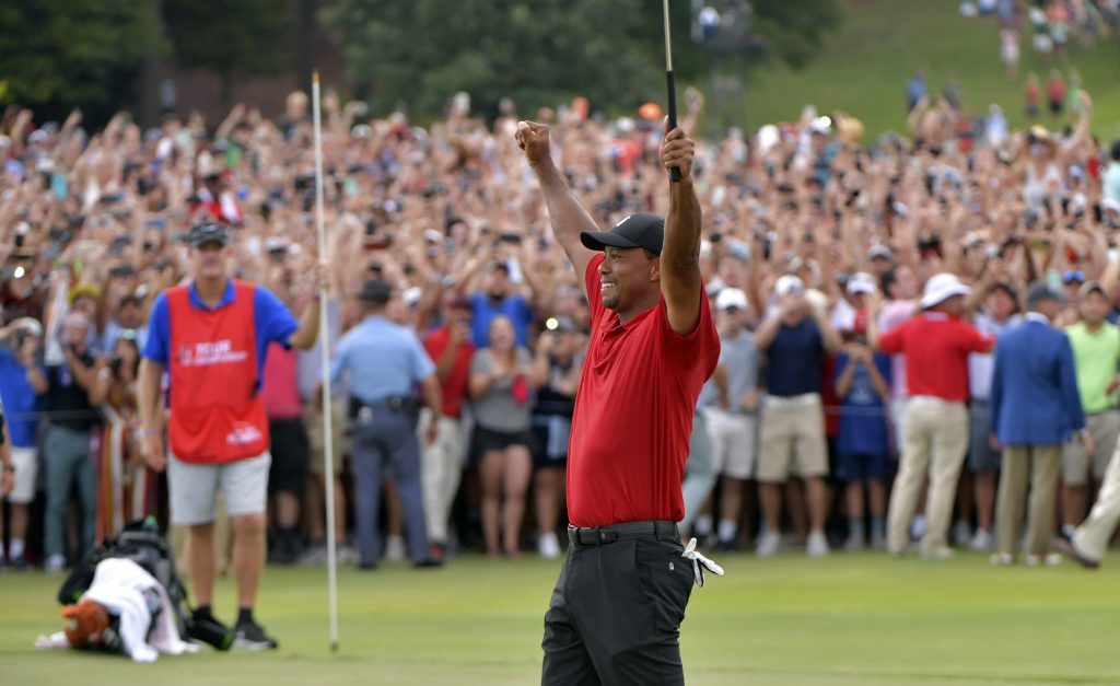Tiger Woods celebrates after winning the Tour Championship on Sunday in Atlanta. The win was Woods' first since 2013.