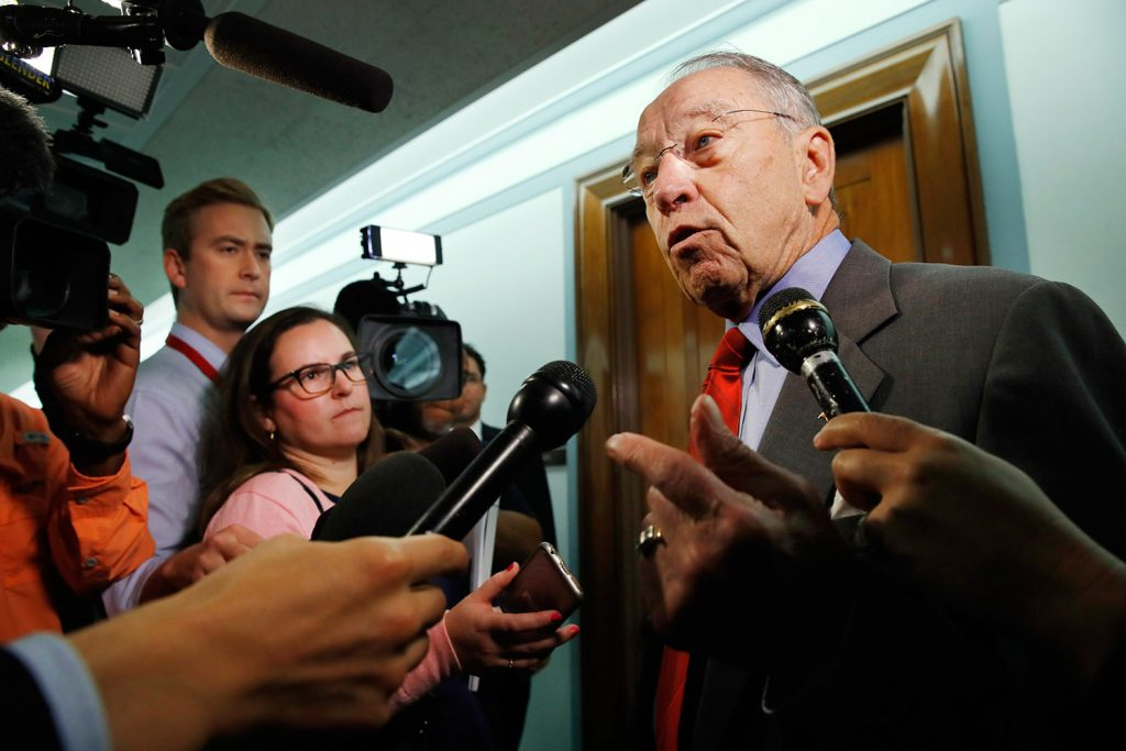 Sen. Chuck Grassley, R-Iowa, right, answers questions from reporters about allegations of sexual misconduct against Supreme Court nominee Brett Kavanaugh on Wednesday as he arrives for a Senate Finance Committee hearing on Capitol Hill in Washington.
