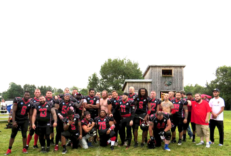 The Twin City Riot of the New England Football League pose for a team photo in August at their new home field in Athens.