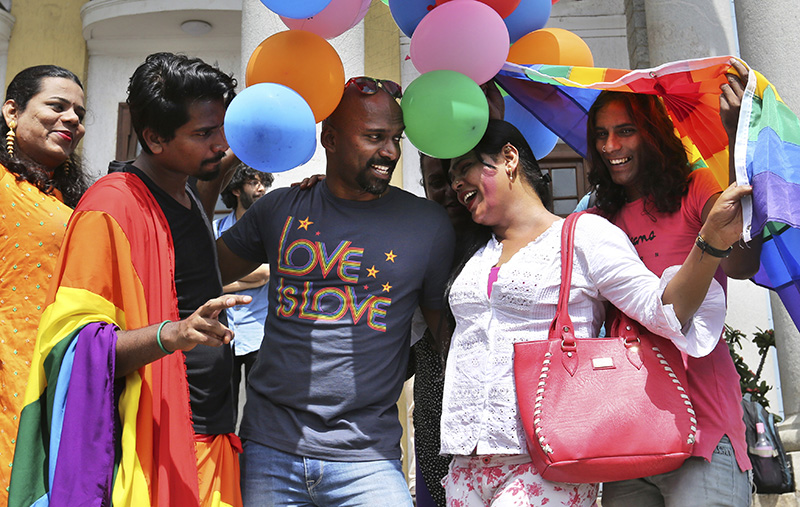 Members of the LGBT community and their supporters celebrate after the India's top court struck down a colonial-era law that made homosexual acts punishable by up to 10 years in prison, in Bangalore on Thursday.