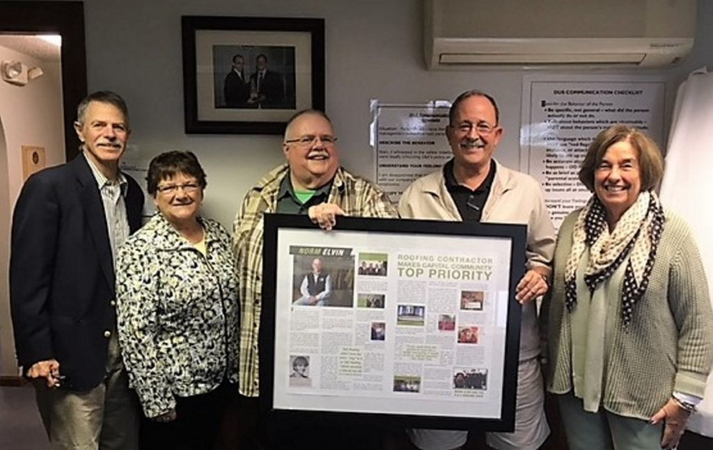 From left are Kennebec Historical Society members Glenn Adams, Nancy Merrick and Roger Pomerleau, G&E Roofing founder Norm Elvin, and KHS President Patsy Crockett.