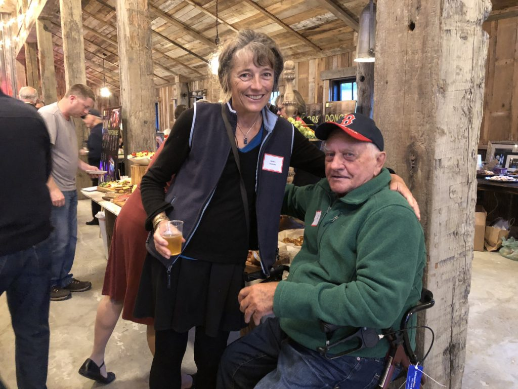 Two past presidents of the RFA Heidi Sorensen, left, and Paul Ellis, at the 50th anniversary party of the organization held on Sept. 25 at the Mountain Star Estate in Rangeley.