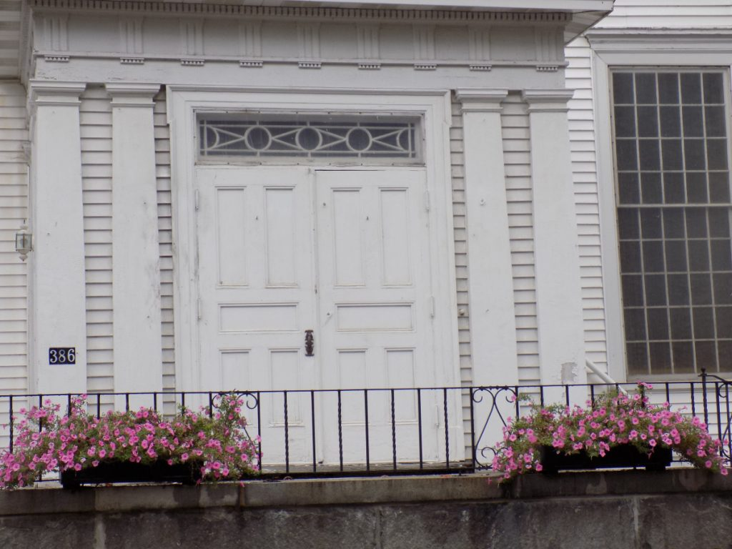 The First Congregational Church on Main Street in Wilton was damaged Monday night when someone set fire to a 200th anniversary banner strung across the front, a state fire investigator said Monday.