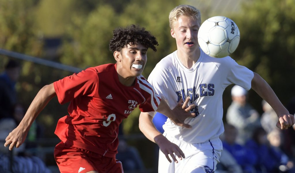 Cony's Ali Albraihi tries to get separation from Erskine's Aidan Larrabee during a Kennebec Valley Athletic Conference game against Cony  on Wednesday in Augusta.
