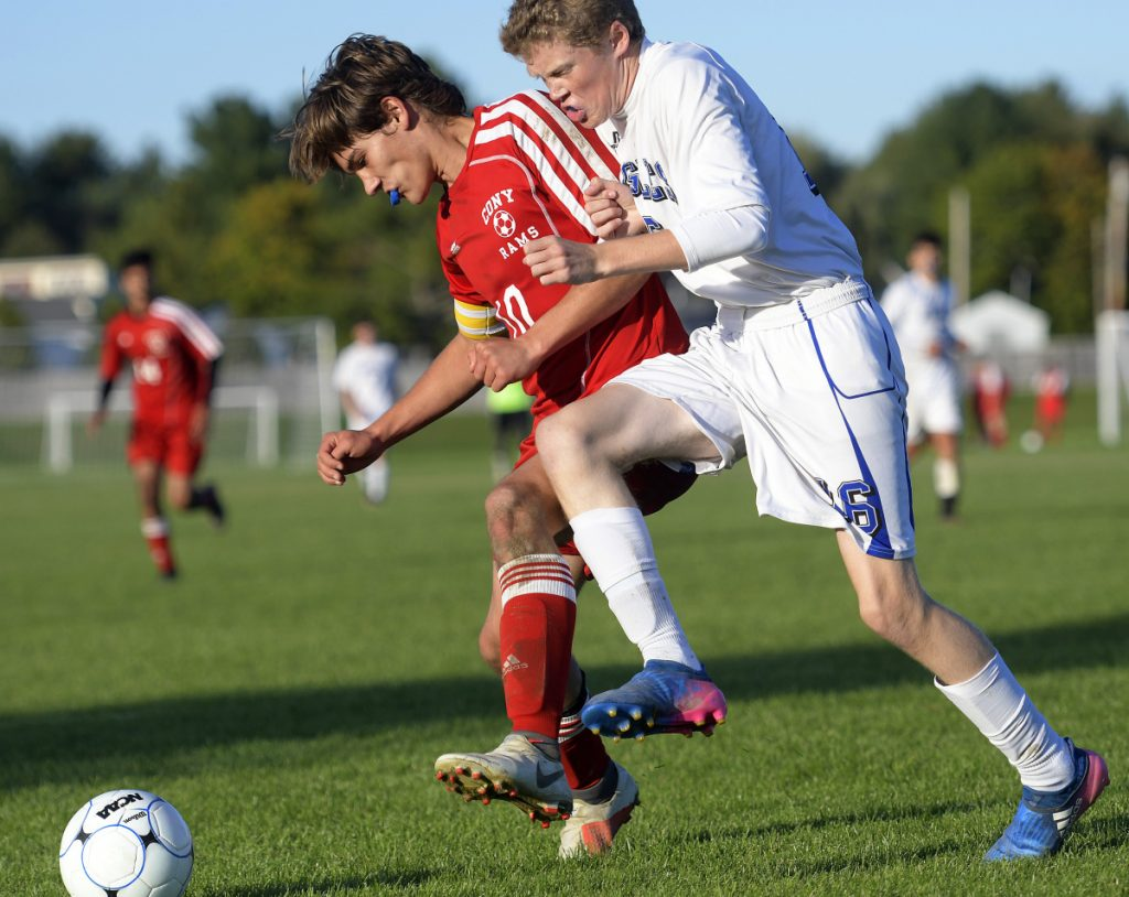 Cony's Alex Cousins, left, and Erskine's Wes McGlew go for possession of the ball during a Kennebec Valley Athletic Conference game against Cony  on Wednesday in Augusta.