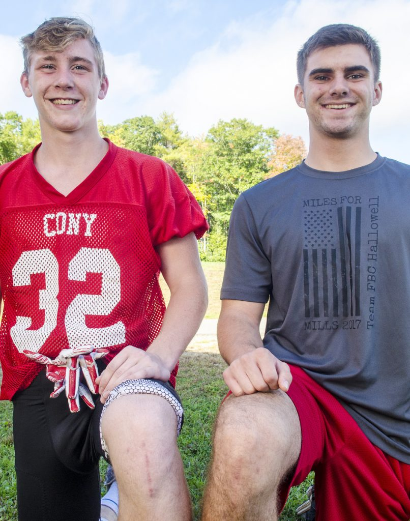 Cony football players Mike Wozniak, left, and Jacob Mills have both recovered from devastating ACL injuries in their knees to become standout players for the Rams defense.