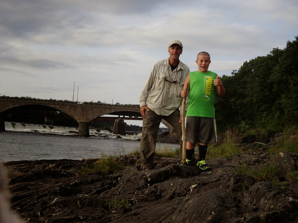 Big Brother Richard Behr, left, and Little Brother Jaxen Wiegand and his hiking on one of their weekly visits as part of their community-based match through Big Brothers Big Sisters of Mid-Maine.