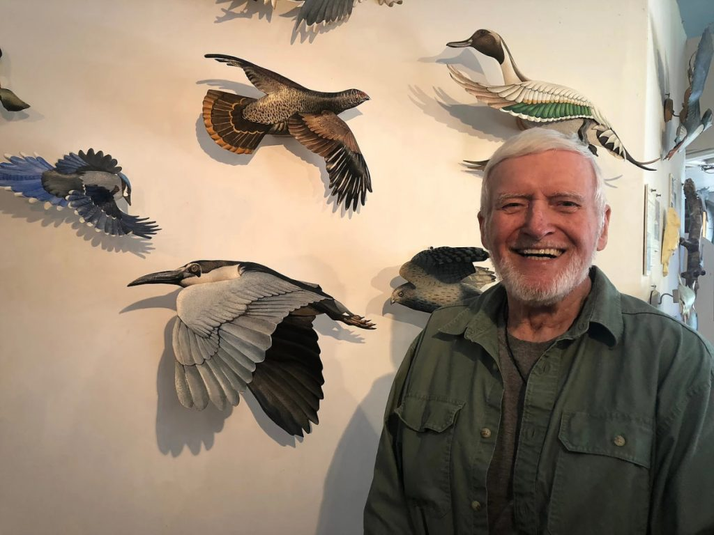 Featured artist Hugh Verrier, 87, creates birds by forming heavy French paper into elegant and life-sized wings, beaks and bodies. He then brings them to life with watercolors. The fish are carefully crafted to mimic an actual fishermen's catch. The results are life-like, light-weight and archival.