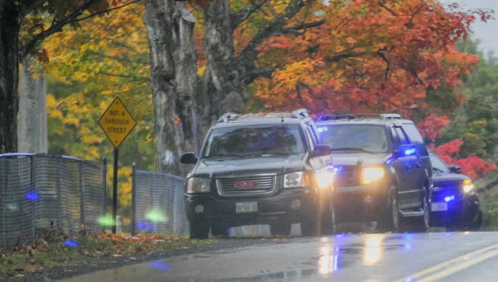 Augusta police leave the scene after making a vehicle stop Tuesday beside Coombs Mills Cemetery on Mount Vernon Road in Augusta. They stopped the vehicle in connection with an investigation into the robbery of a Subway on Bangor Street in Augusta.