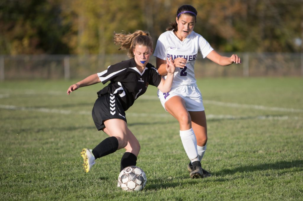 Winslow's Hannah Dugal, left, takes control of the ball as Waterville defender Lauren Pinnette closes in during a Kennebec Valley Athletic Conference Class B game Friday afternoon in Winslow.