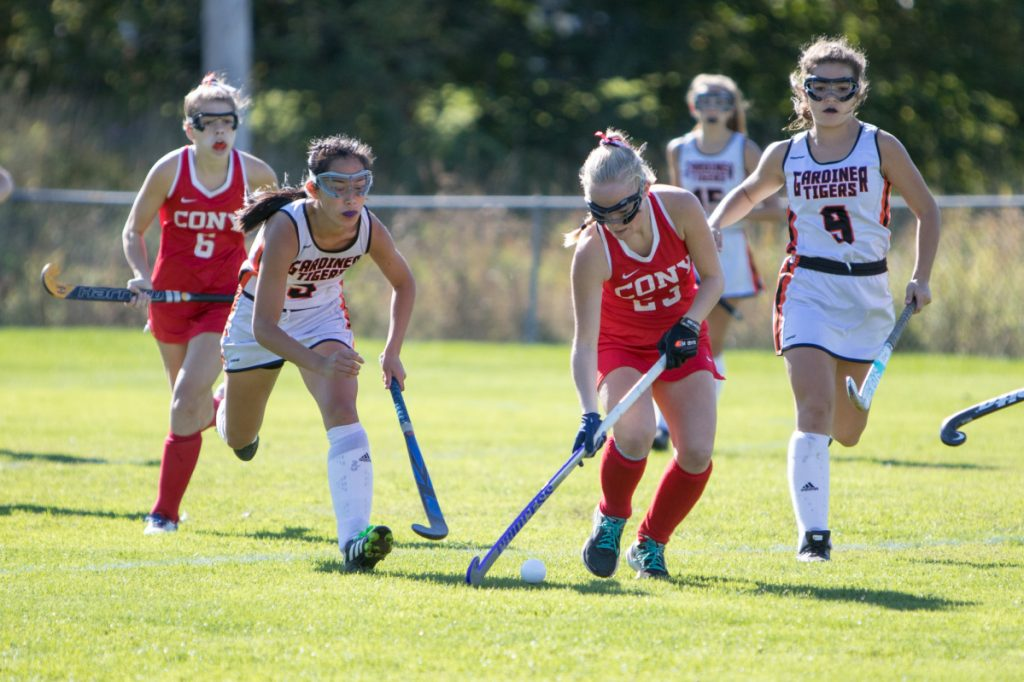 Cony sophomore Anna Reny takes control of the ball while Gardiner senior Sarah Foust closes in to defend during a game Saturday in Gardiner.