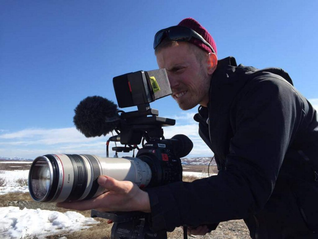 "David Lovejoy, a 2006 Messalonskee High School graduate, takes aim on the set of ""Life Below Zero,"" a BBC Worldwide production airing on the National Geographic Channel that is filmed in Alaska. Lovejoy was one of eight crew members to win an Emmy Award for Outstanding Cinematography for a Reality Program for his work on the show."
