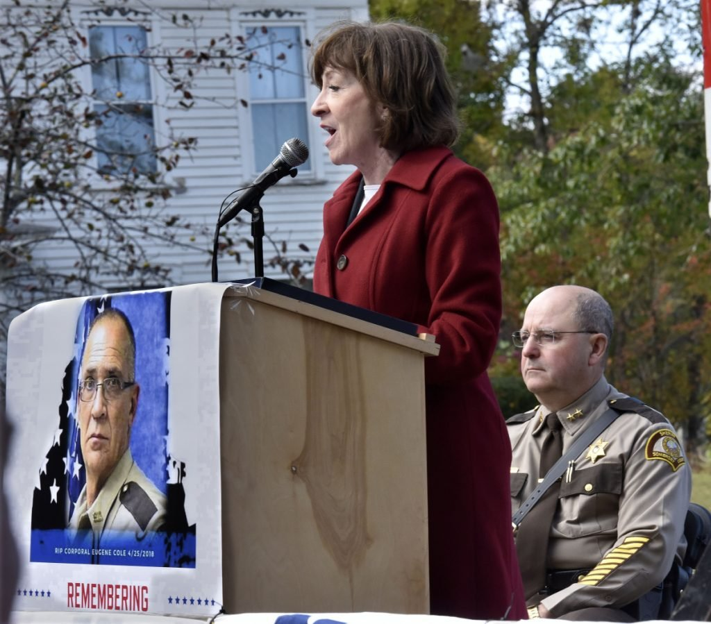 Sen. Susan Collins addresses hundreds of family, friends, police and rescue personnel at the Corporal Eugene Cole Memorial Bridge dedication ceremony in Norridgewock on Sunday. At right is Somerset Sheriff Dale Lancaster.