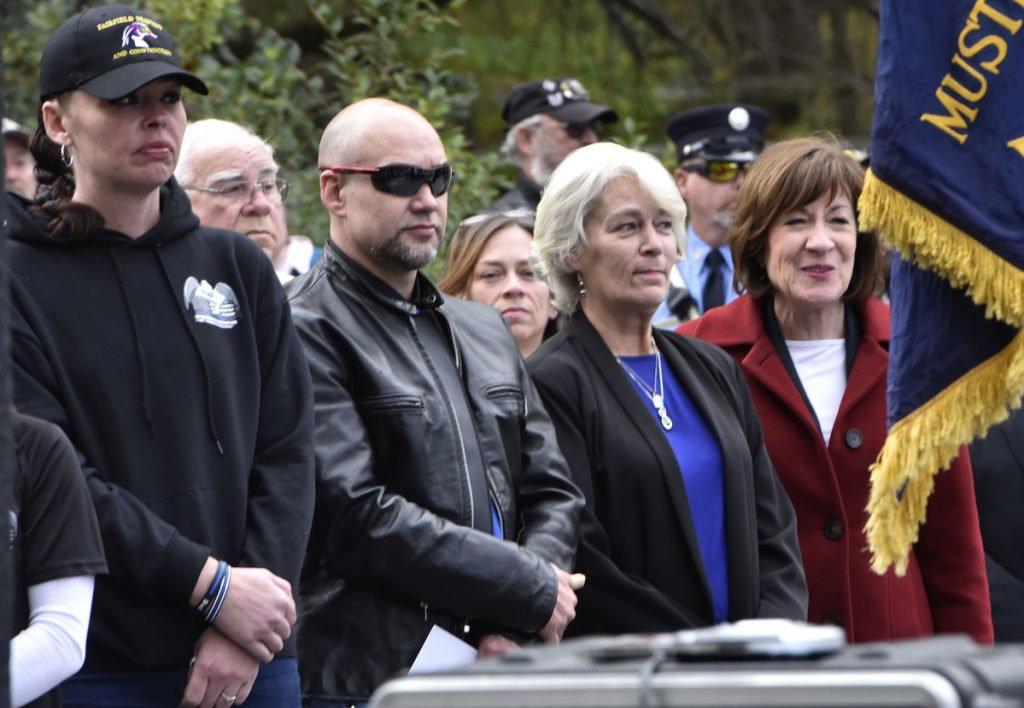 "U.S. Sen. Susan Collins, R-Maine, right, stands beside Sheryl Cole, widow of slain Somerset Sheriff Deputy Cpl. Gene Cole and other family members during the dedication of the Corporal Eugene Cole Memorial Bridge in Norridgewock on Sunday. Collins later said had been hearing ""very positive"" feedback from Mainers regarding her vote the day before to confirm now-Supreme Court Justice Brett Kavanaugh."