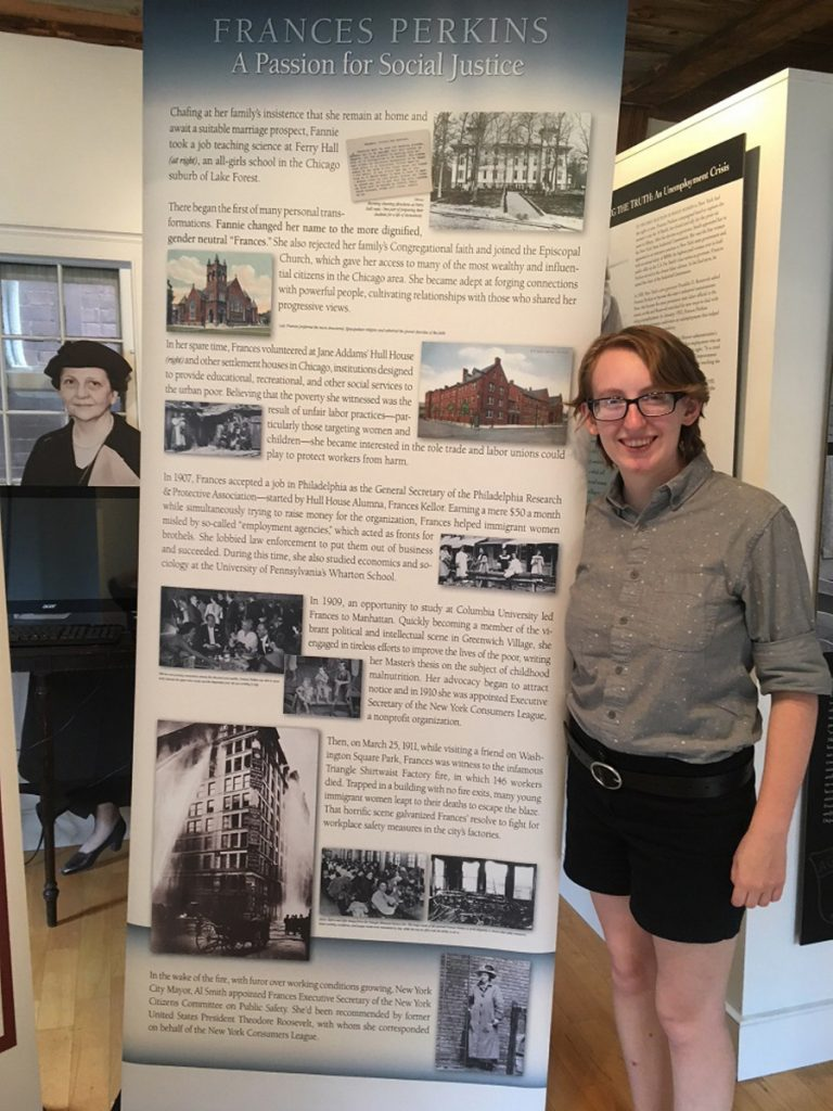 2018 Mount Holyoke College/Frances Perkins Center intern Ally Kelley with a travel exhibit panels.