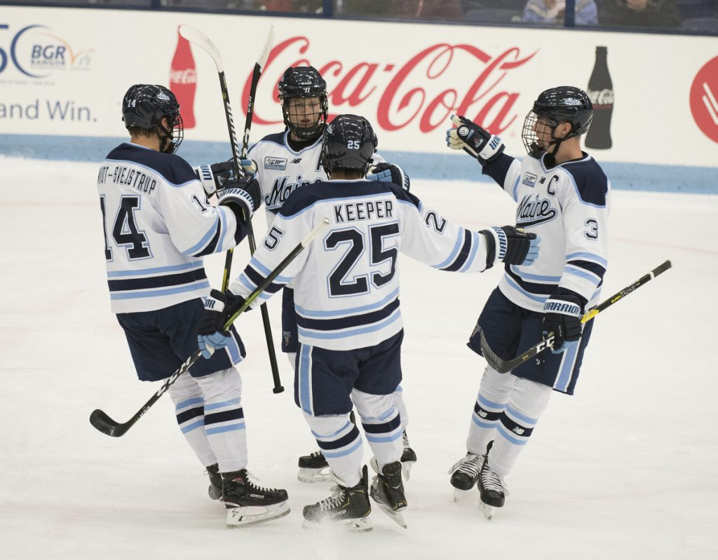 From left to right, UMaine's Jacob Schmidt-Svejstra, Mitchell Fossier, Brady Keeper and Rob Michel celebrate Fossier's second goal of the night against UPEI at Alfond Arena in Orono on Monday.