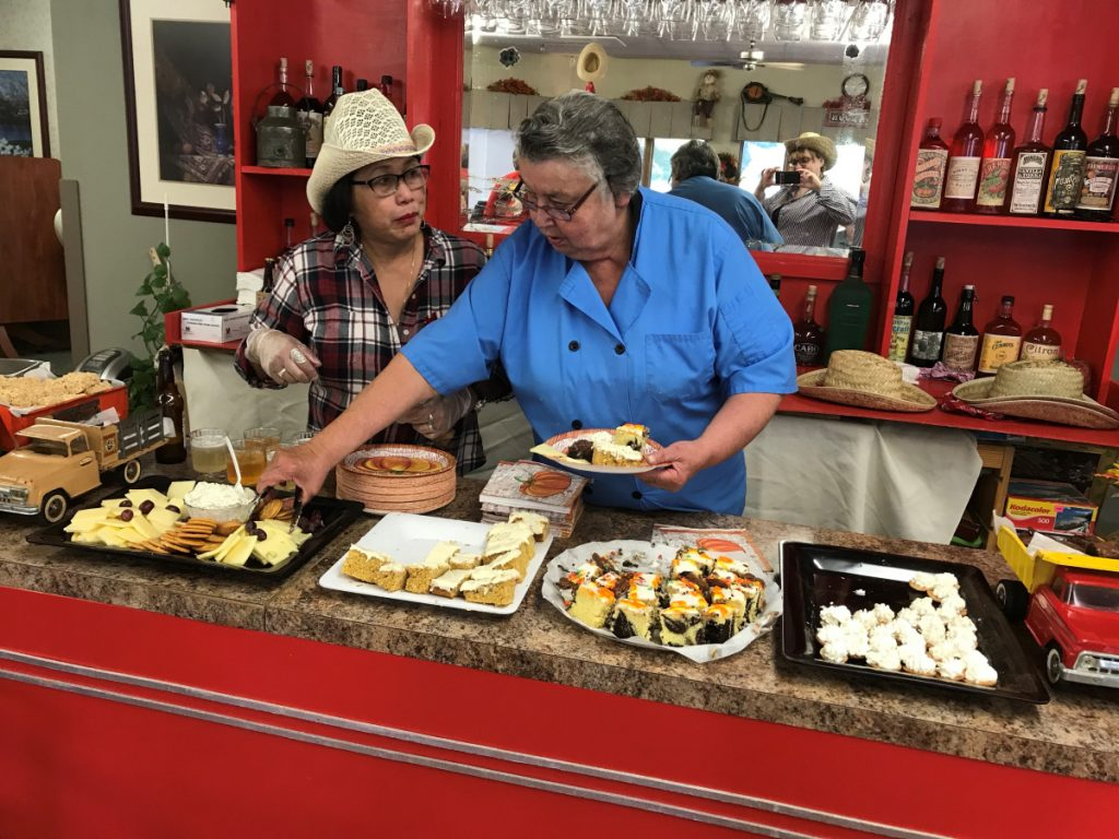 Recreation assistant Leni McCandless and Food Service director Eileen Franklin serving from the Saloon.