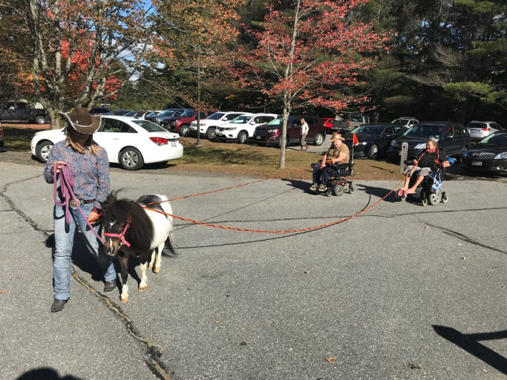 Oreo the horse accompanied by Rebecca Stone, left, escort King Daniel Campbell, center, Queen Gwen Nyholt, right.